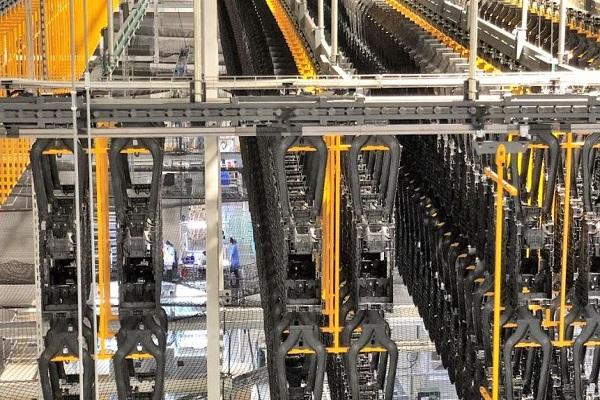 Ferag instala su mayor sistema de transporte por gravedad en China